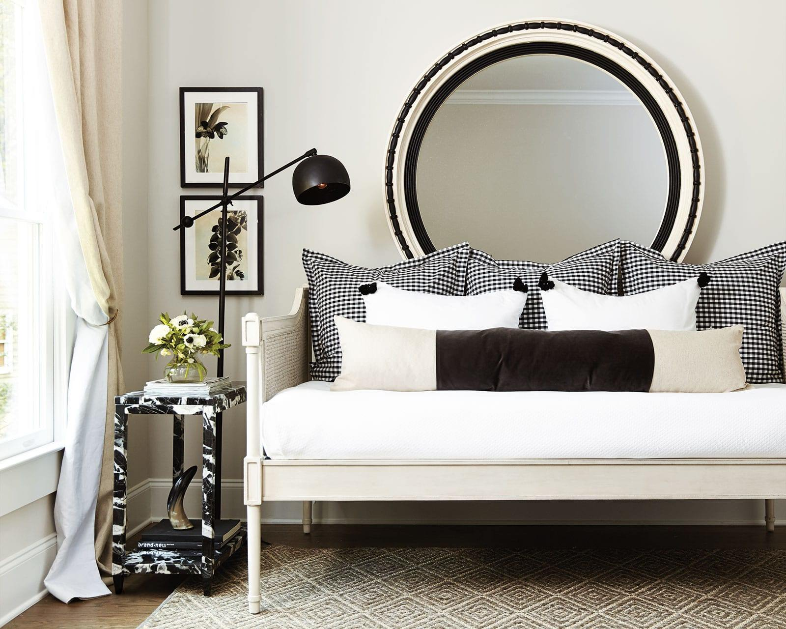 White bedroom with dark wood