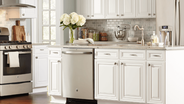 By lining one wall with cabinets, enough storage is created so that the  rest of the room can be open and uncluttered