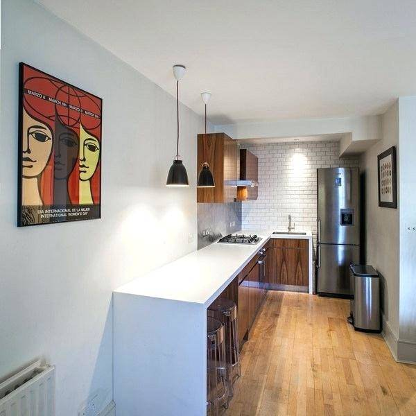 L Shaped Kitchen Design India: Kitchen by Scale Inch Pvt