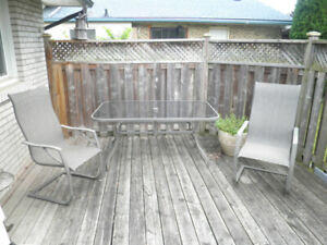 , backyard is at once chic, comfy and  casual