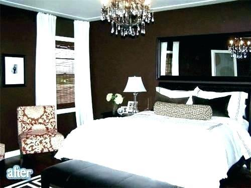 A warm and cozy bedroom with dark hardwood floors and brown paint