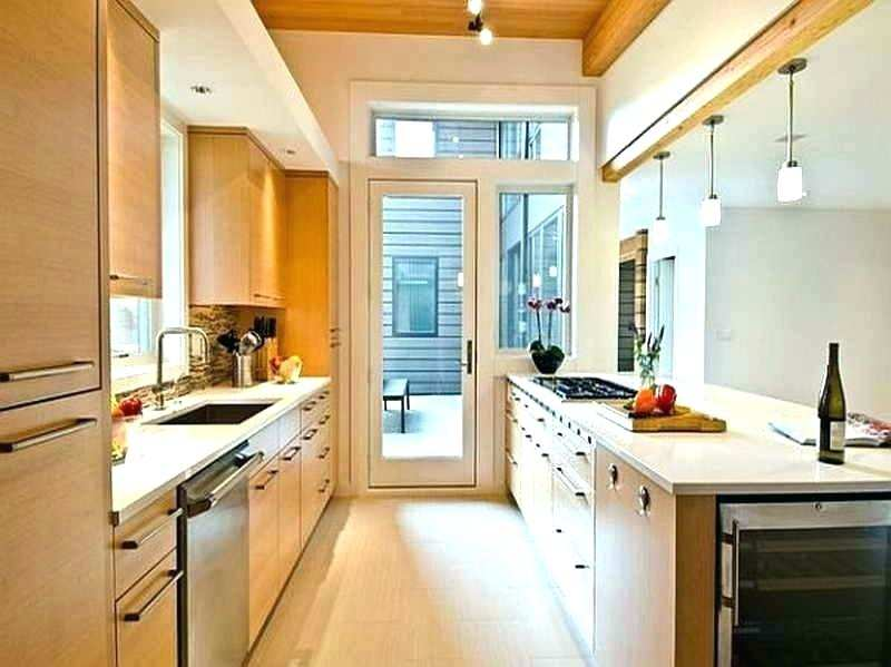 Make It Work: Smart Design Solutions for Narrow Galley Kitchens open cubbies above the cabinets for stashing cookbooks and infrequently used appliances